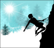 Silhouette of a climber on a background of winter landscape Stock Photo