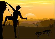 Silhouette of a climber on a rock Stock Images