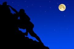 Silhouette  climbers evening. Stock Image