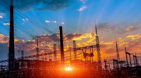 Silhouette of coal electric power plant on the background of a beautiful sunset. Stock Photo