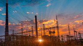Silhouette of coal electric power plant on the background of a beautiful sunset. Stock Images