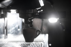 Silhouette of coffee making process; espresso cup and coffee mac Royalty Free Stock Image