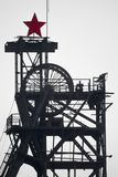 Silhouette colliery coal mine with wheels and soviet star royalty free stock photo