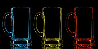Silhouette of color beer glass on black background Stock Photos