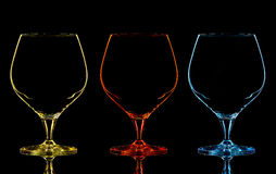 Silhouette of color whiskey glass on black. Background Stock Photo