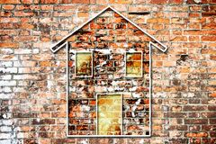 Silhouette of a colored house on a brick wall Royalty Free Stock Photo