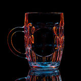 Silhouette of colorful beer glass with clipping path on black background Royalty Free Stock Images