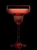 Silhouette of colorful margarita glass on black Stock Images