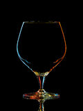 Silhouette of colorful whiskey glass with clipping path on black background Royalty Free Stock Image