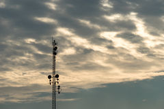 Silhouette Communication tower with cloudy sky Stock Image