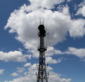 Silhouette communicatios tower  against the sky Royalty Free Stock Photos