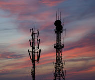 Silhouette communicatios tower  against the sky Royalty Free Stock Images