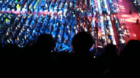 Silhouette concert crowd in front of stage stock footage
