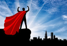 Silhouette of confident businessman superman looking at metropolis city. Superman is a businessman superhero. Silhouette of confident businessman superman Stock Photos