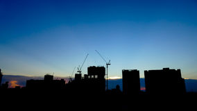 Silhouette construction building. City in twilight sky Stock Image