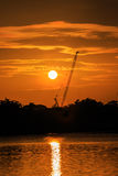 Silhouette Construction crane at sunrise. Silhouette shot of a construction crane taken at sunrise Royalty Free Stock Images