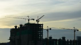 Silhouette of Construction crane with sunrise sky, Timelapse stock video footage