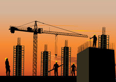 Silhouette of construction site. With workers and scaffolding at sunset sky Royalty Free Stock Image