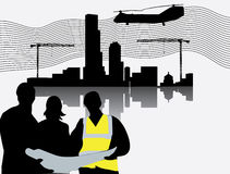 Silhouette of construction site with crane towers Stock Photos