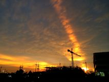 The Silhouette of construction site under sunset. Silhouette construction site in Bangkok under beautiful sunset Stock Photo