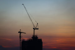 Silhouette of construction tower. Silhouette of construction site with background of twilight sky Stock Image