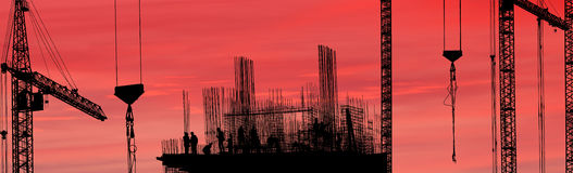 Silhouette of construction worker. Construction workers silhouette against the sunset, panorama Stock Photography