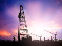 Silhouette construction worker in a building site over Blurred c Royalty Free Stock Photos