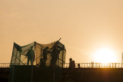 Silhouette of Construction Worker Stock Images