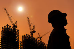 The Silhouette of Construction workers royalty free stock photography