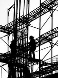 Silhouette of Construction Workers. High up on the scaffolding Stock Photo