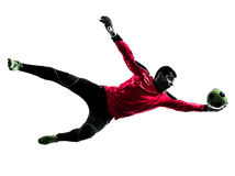 Silhouette contagieuse de boule de footballeur d'homme caucasien de gardien de but Photographie stock libre de droits