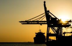 Silhouette of container cargo and crane bridge.  Stock Image