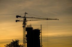 Silhouette, contruction, crane, at, sunrise Royalty Free Stock Images