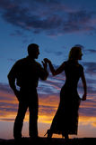 Silhouette copule hold hands sunset look away Stock Image