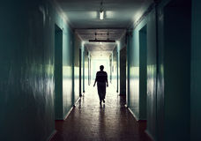 Silhouette in a corridor royalty free stock photo