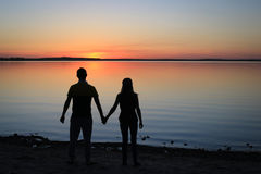 Silhouette of a couple at the beach in the Sunset Stock Image