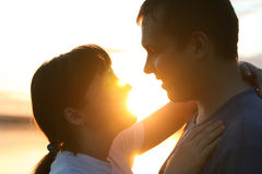 Silhouette couple. Embracing at sunset Stock Photo