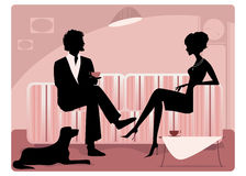 Silhouette of a couple. Having coffee and talking Royalty Free Stock Photography