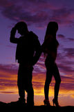 Silhouette of couple back to back in the sunset Royalty Free Stock Photography