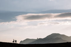 Silhouette of couple on the background of the beautiful mountains of the mountains. Horizontal shot. Natural light Stock Image