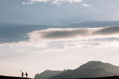 Silhouette of couple on the background of the beautiful mountains of the mountains. Horizontal shot. Natural light Royalty Free Stock Photography
