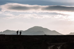 Silhouette of couple on the background of the beautiful mountains of the mountains. Horizontal shot. Natural light Stock Photography
