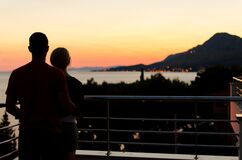Silhouette of Couple on Balcony Stock Photo