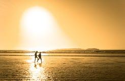 Silhouette of a Couple on beach Stock Photos
