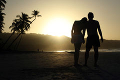 Silhouette couple at the beach Stock Image