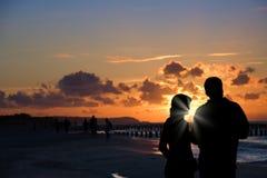 Silhouette of couple on beach Stock Photos