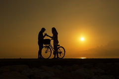 Silhouette couple at beach Stock Photography