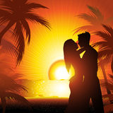 Silhouette of couple  on beach at sunset Stock Image