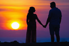 Silhouette of couple at beautiful sunset background Royalty Free Stock Image