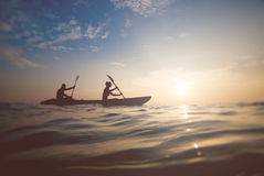 silhouette of a couple on a boat royalty free stock photography